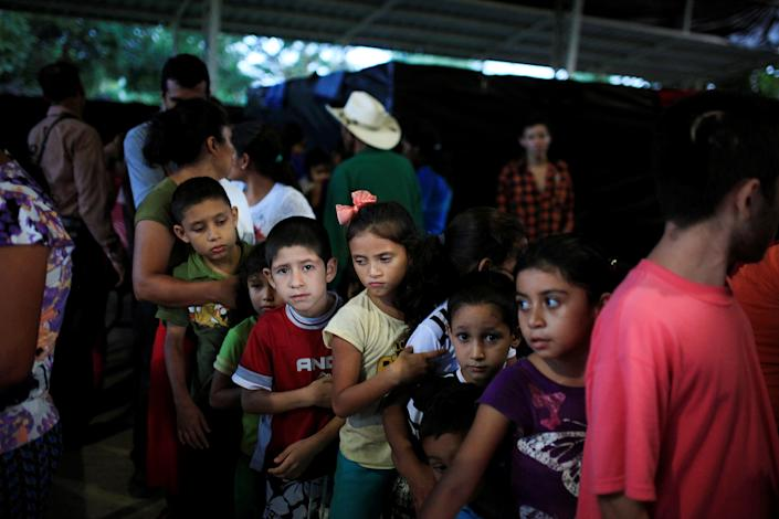 Children from El Castano village line up for dinner at a shelter in Caluco, El Salvador, on Sept. 26, 2016, after leaving home because of death threats from Barrio 18 gang members. (Photo: Jose Cabezas/Reuters)