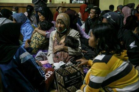 Villagers living near Mount Merapi volcano take shelter in a village hall following a series of minor eruptions in Cangkringan, Sleman, Yogyakarta, Indonesia May 21, 2018 in this photo taken by Antara Foto. Antara Foto/ Hendra Nurdiyansyah/ via REUTERS