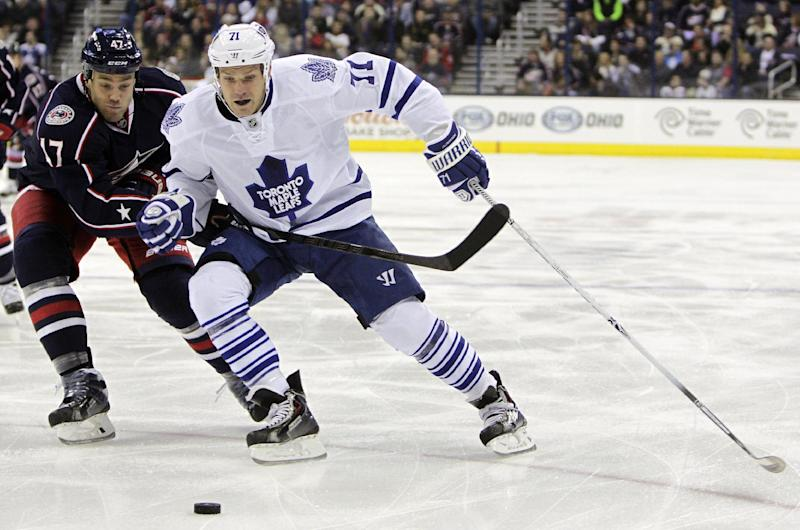 Toronto Maple Leafs' David Clarkson, right, carries the puck upice as Columbus Blue Jackets' Dalton Prout defends during the first period of an NHL hockey game on Friday, Oct. 25, 2013, in Columbus, Ohio. (AP Photo/Jay LaPrete)