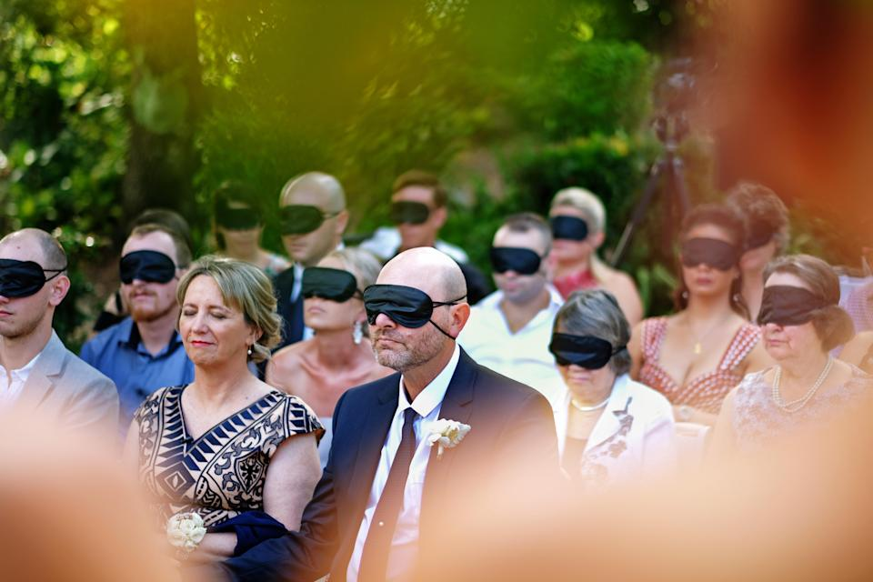 The guests wore blindfolds to approximate the bride's experience. (Photo: James Day)