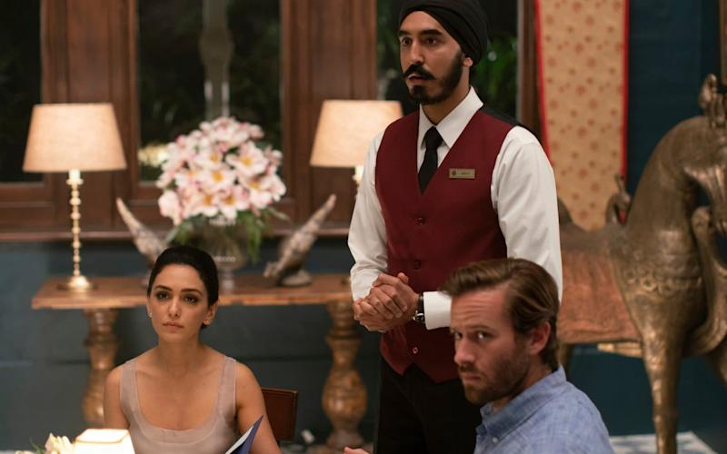 Nazanin Boniadi, from left, Dev Patel and Armie Hammer in a scene from 'Hotel Mumbai' - Bleecker Street