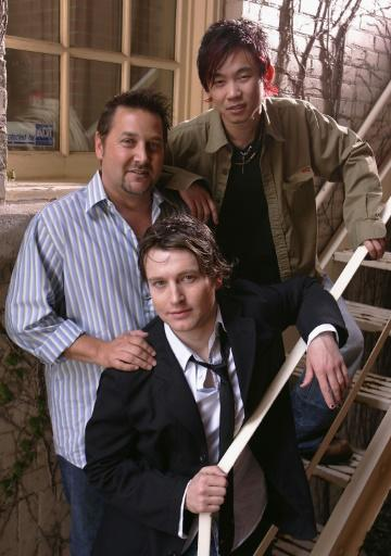 Actor Leigh Whannell (C) producer Greg Hoffman (L) and director James Wan pose for a portrait while promoting their film 'Saw' at the Toronto International Film Festival September 15, 2004
