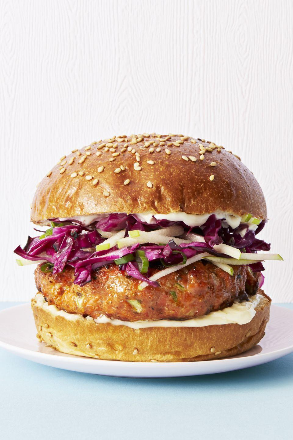 """<p>With curry powder and an apple, cabbage, and cider vinegar slaw, these salmon burgers might just outrank your go-to beef recipe.</p><p><a href=""""https://www.goodhousekeeping.com/food-recipes/easy/a45232/salmon-burgers-cabbage-apple-slaw-recipe/"""" rel=""""nofollow noopener"""" target=""""_blank"""" data-ylk=""""slk:Get the recipe for Salmon Burgers with Cabbage-Apple Slaw »"""" class=""""link rapid-noclick-resp""""><em>Get the recipe for Salmon Burgers with Cabbage-Apple Slaw »</em></a></p>"""