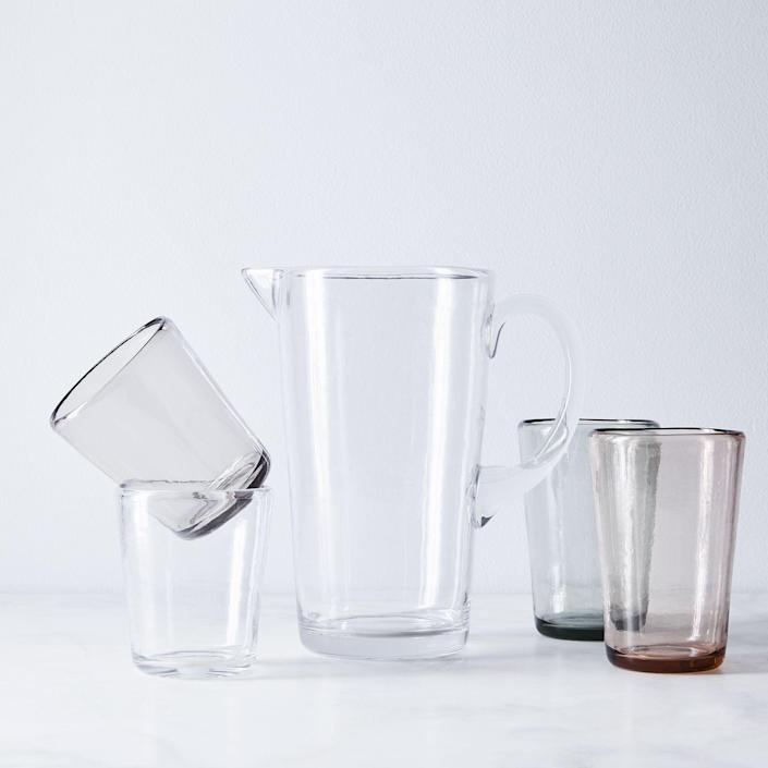 """It may look like glass, but this one is actually made of melamine, which means it's more or less indestructible (okay, don't quote us on that, but it's pretty tough). $29, Food52. <a href=""""https://food52.com/shop/products/4888-veranda-outdoor-pitcher-tumblers"""" rel=""""nofollow noopener"""" target=""""_blank"""" data-ylk=""""slk:Get it now!"""" class=""""link rapid-noclick-resp"""">Get it now!</a>"""