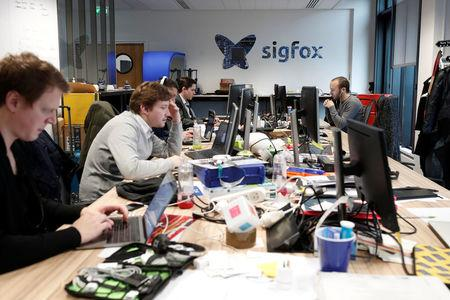 Employees work on computers at the French start-up Sigfox offices in Paris, France, February 14, 2018. REUTERS/Benoit Tessier