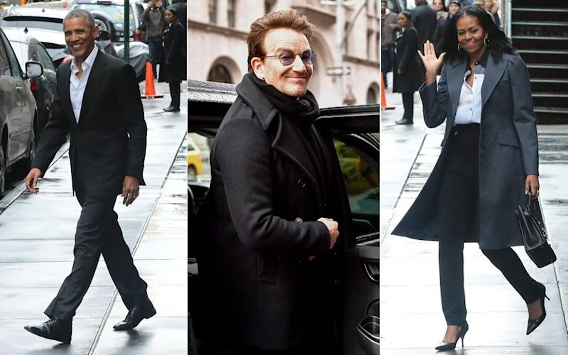 Barack and Michelle Obama received a standing ovation as they met with U2's lead singer Bono in New York