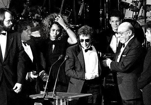 Phil Spector flanked by Tina Turner and Ahmet Ertegun at the Rock and Roll Hall of Fame Awards in NYC, January 1989.