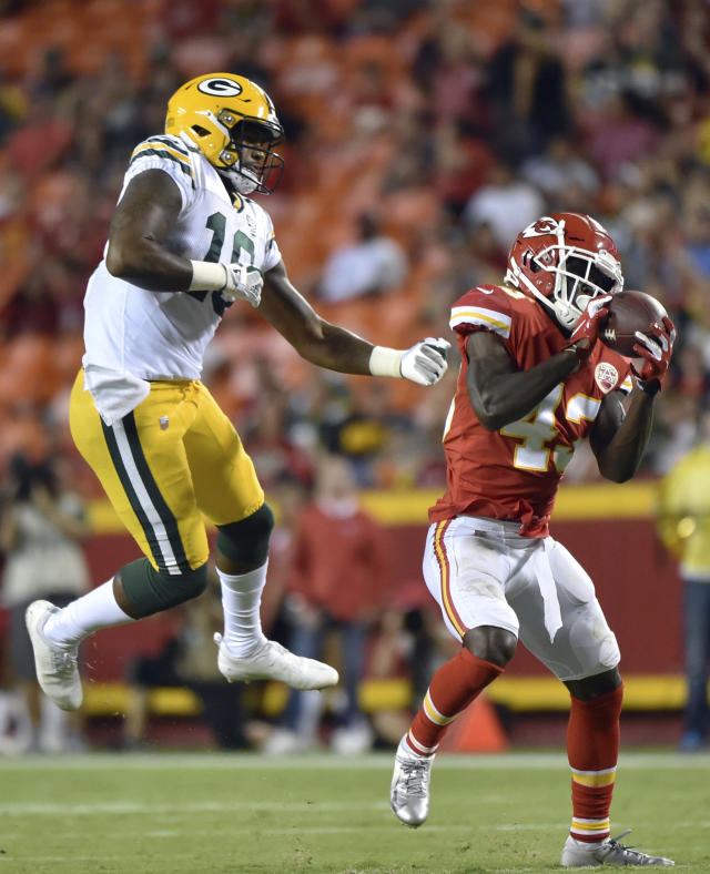 Kansas City Chiefs cornerback Makinton Dorleant (43) intercepts a pass intended for Green Bay Packers wide receiver DeAngelo Yancey (10) and runs for a touchdown during the second half of an NFL preseason football game in Kansas City, Mo., Thursday, Aug. 30, 2018. (AP Photo/Ed Zurga)
