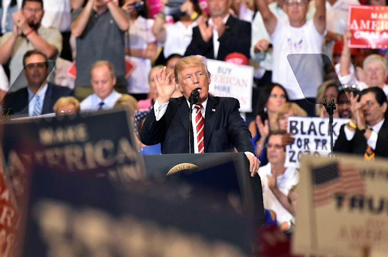 "President Donald Trump speaking at a ""Make America Great Again"" rally in Phoenix, Arizona, where he defended his response to the recent violence in Charlottesville, Virginia (AFP Photo/Nicholas Kamm)"