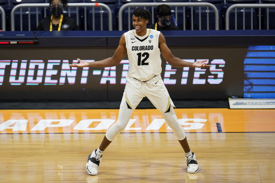 Colorado forward Jabari Walker (12) celebrates a three-point basket against Georgetown in the first half of a first-round game in the NCAA men's college basketball tournament at Hinkle Fieldhouse in Indianapolis, Saturday, March 20, 2021. (AP Photo/Michael Conroy)