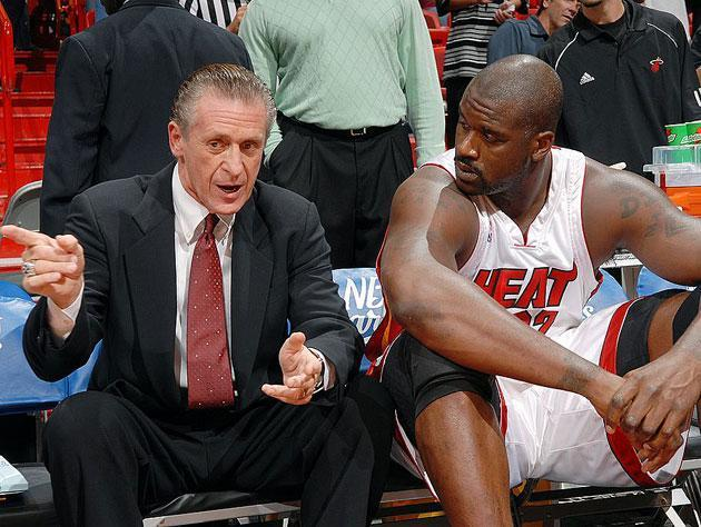 Pat Riley and Shaq discuss the Jamal Mashburn-for-Sasha Danilovic deal. (Getty Images)