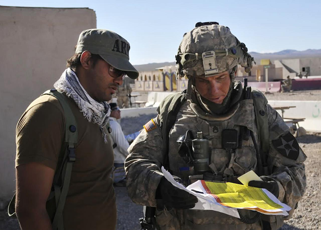 In this Aug. 23, 2011 Defense Video & Imagery Distribution System photo, Army Staff Sgt. Robert Bales, right, participates in an exercise at the National Training Center at Fort Irwin, Calif. Five days after an attack on Afghan villagers killed 16 civilians, a senior U.S. official identified the shooter in that attack as Bales. The man at left is unidentified. (AP Photo/DVIDS, Spc. Ryan Hallock)