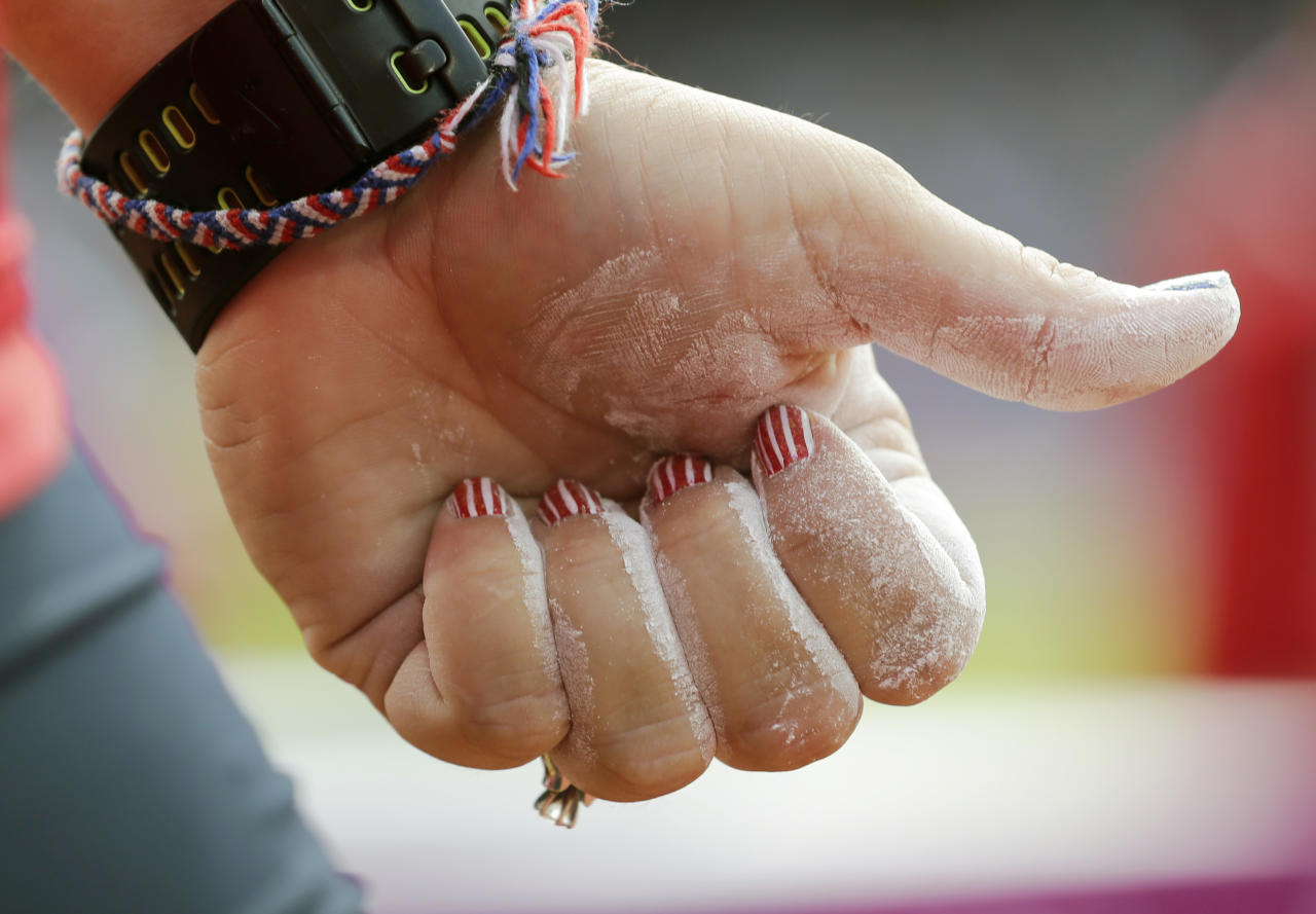 The nails of United States' Jillian Camarena-Williams are seen in a women's shot put qualification round during the athletics in the Olympic Stadium at the 2012 Summer Olympics, London, Monday, Aug. 6, 2012. (AP Photo/David J. Phillip )