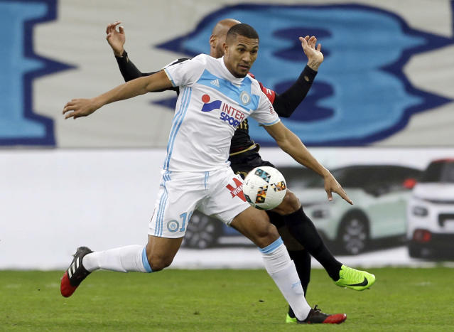 FILE - In this Wednesday, Feb. 8, 2017 file photo, Marseille's midfielder William Vainqueur, front, challenges for the ball with Guingamp's forward Jimmy Briand during the League One soccer match between Marseille and Guingamp, at the Velodrome Stadium, in Marseille, southern France. Two days after failing a medical due to a calf problem, in a statement on Saturday Jan. 12, 2019, Monaco said midfielder William Vainqueur has joined struggling Monaco on loan from Turkish club Antalyaspor. (AP Photo/Claude Paris, File)