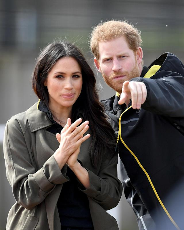 Meghan Markle, pictured with Prince Harry, wore a khaki-green coat at the University of Bath Sports Training Village to attend the U.K. team trials for the Invictus Games. (Photo: Getty Images)