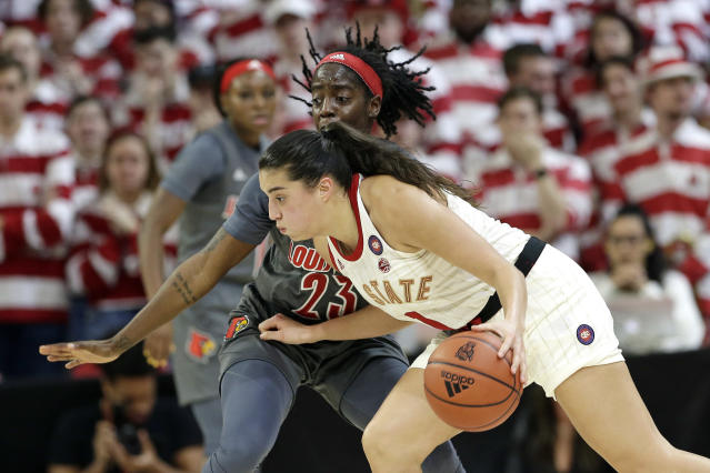 Louisville guard Jazmine Jones (23) guards North Carolina State guard Aislinn Konig during the first half of an NCAA college basketball game in Raleigh, N.C., Thursday, Feb. 13, 2020. (AP Photo/Gerry Broome)