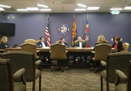 FILE - In this Dec. 27, 2019, file photo, the Maricopa County Board of Supervisors meets in Phoenix. The board that oversees Arizona's most populous county has scheduled a special meeting Friday, Sept. 17, 2021, where members may announce whether they will comply with a state Senate subpoena to hand over its computer routers for examination by contractors conducting an unprecedented partisan review of 2020 election results. (AP Photo/Terry Tang, File)