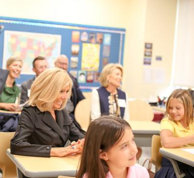 Mrs. Brigitte Macron, First Lady of France, listens as grade 5 students at The Windward School's Manhattan campus are taught a decoding skills lesson in their language arts class.