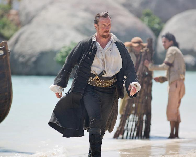 """This publicity photo provided by Starz Entertainment, LLC shows, from left, Toby Stephens as Captain Flint, in a scene from """"Black Sails."""" (AP Photo/Copyright Starz Entertainment, LLC, Keith Bernstein)"""