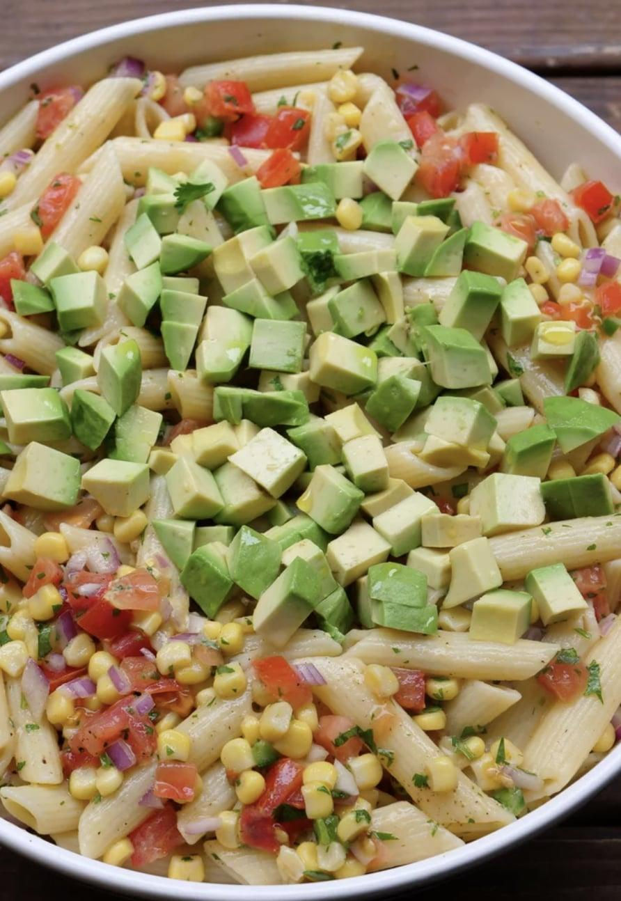 """<p>If you like corn, this salad will be your new favorite creation. It's the perfect barbecue dish since it's light and fresh, and it pairs exceptionally well with a burger or grilled chicken. You can't go wrong with making too much because it's even better cold, so the bigger the better!</p> <p><strong>Get the recipe:</strong> <a href=""""https://www.laylita.com/recipes/corn-pasta-salad-with-tomato-and-avocado/"""" class=""""link rapid-noclick-resp"""" rel=""""nofollow noopener"""" target=""""_blank"""" data-ylk=""""slk:corn pasta salad with tomato and avocado"""">corn pasta salad with tomato and avocado</a></p>"""