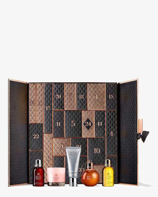 """<p><strong>Molton Brown</strong></p><p>olivela.com</p><p><strong>$250.00</strong></p><p><a href=""""https://go.redirectingat.com?id=74968X1596630&url=https%3A%2F%2Fwww.olivela.com%2Fproducts%2Fmolton-brown-advent-calendar-200640&sref=https%3A%2F%2Fwww.harpersbazaar.com%2Fbeauty%2Fg33667621%2Fbest-beauty-advent-calendars%2F"""" rel=""""nofollow noopener"""" target=""""_blank"""" data-ylk=""""slk:Shop Now"""" class=""""link rapid-noclick-resp"""">Shop Now</a></p><p>For those who want their calendars to look as luxurious as the treats inside, pick up Molton Brown's 24-day box. It has a little bit of everything for the body-care lover—oils, lotion, hair care, and even mini scented candles.</p>"""