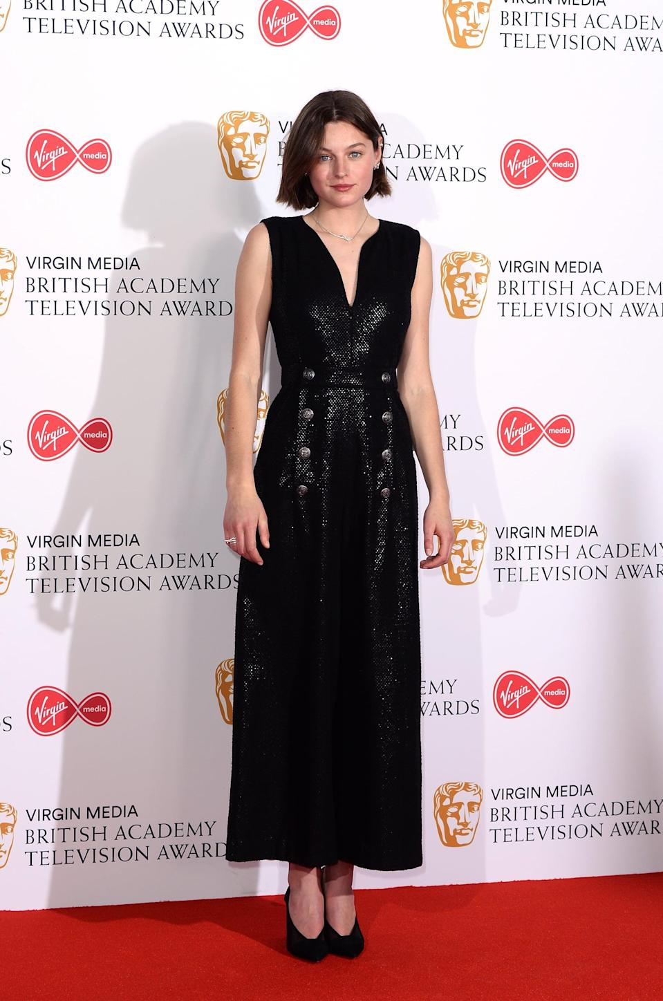 <p>A full-length black outfit seems to be Emma Corrin's look of choice at red carpet events. The actor wore a shimmering black jumpsuit to the 2019 BAFTA Television Awards. </p>