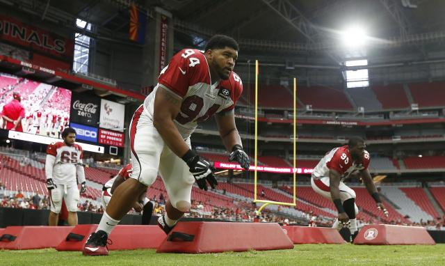 Arizona Cardinals' Xavier Williams (94) and Rodney Gunter (95) run drills with the defensive linemen during an NFL football training camp Saturday, July 29, 2017, in Glendale, Ariz. (AP Photo/Ross D. Franklin)