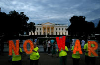 "Protesters hold signs spelling out, ""No War,"" outside the White House, Thursday June 20, 2019, in Washington, after President Donald Trump tweeted that ""Iran made a very big mistake"" by shooting down a U.S. surveillance drone over the Strait of Hormuz in Iran. (AP Photo/Jacquelyn Martin)"
