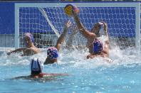 <p>Players from the U.S. and Croatia fight for the ball. (Reuters) </p>