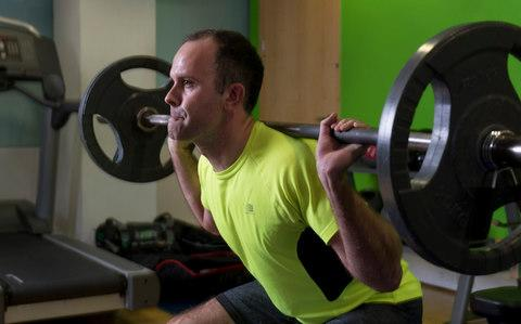 James Carson lifting weights after his recovery from a hernia - Credit:  Geoff Pugh for the Telegraph