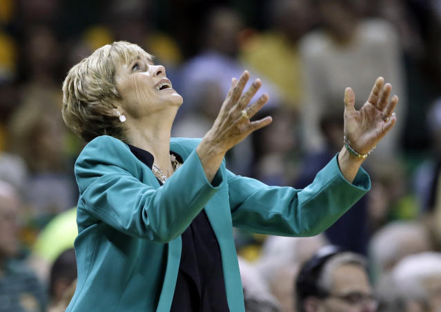 Baylor head coach Kim Mulkey throws her hands up after her team was charged with a foul in the first half of an NCAA college basketball game against Connecticut, Monday, Jan. 13, 2014, in Waco, Texas. (AP Photo/Tony Gutierrez)