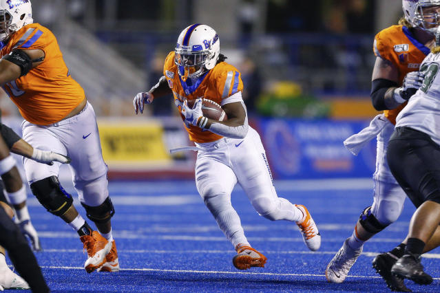 Boise State running back Robert Mahone carries against Hawaii during the first half of an NCAA college football game Saturday, Oct. 12, 2019, in Boise, Idaho. (AP Photo/Steve Conner)