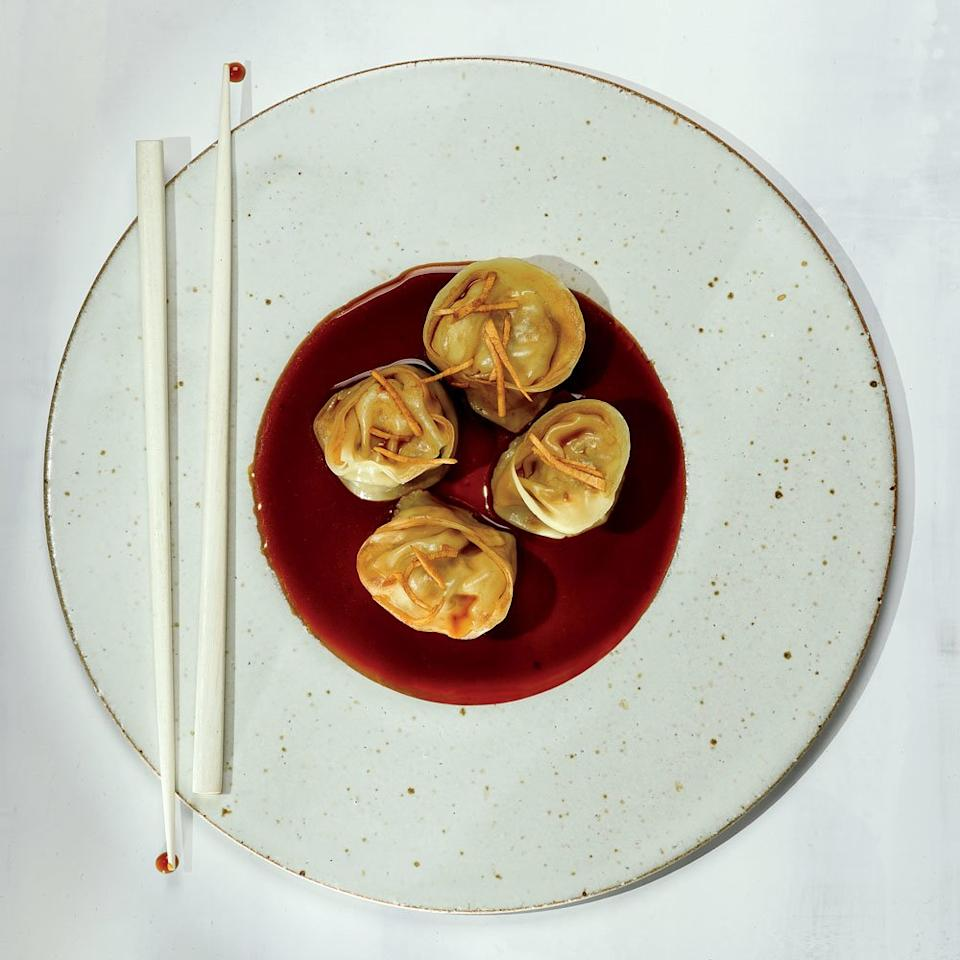 """<p>F&W Best New Chef 2017 Peter Cho, of Han Oak in Portland, Oregon, says that this is a cheater version of his favorite <em>xiao long bao</em> (soup dumplings). """"I love when you poke the side of a soup dumpling and the rich, porky chicken stock spills out into your spoon and mixes with the black vinegar dipping sauce. For my version, I took the difficulty out of making and filling the dumplings by instead just serving them with a rich chicken stock–and–vinegar dipping sauce.""""</p><p><a href=""""https://www.foodandwine.com/recipes/pork-and-chive-dumplings"""">GO TO RECIPE</a></p>"""