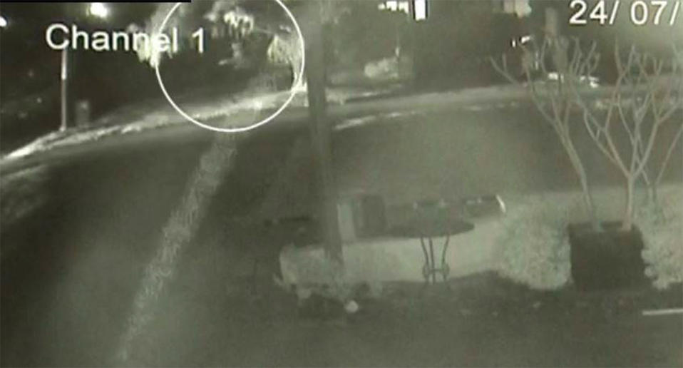 Security camera footage shows a man skateboarding down a street in Perth before a fatal accident.