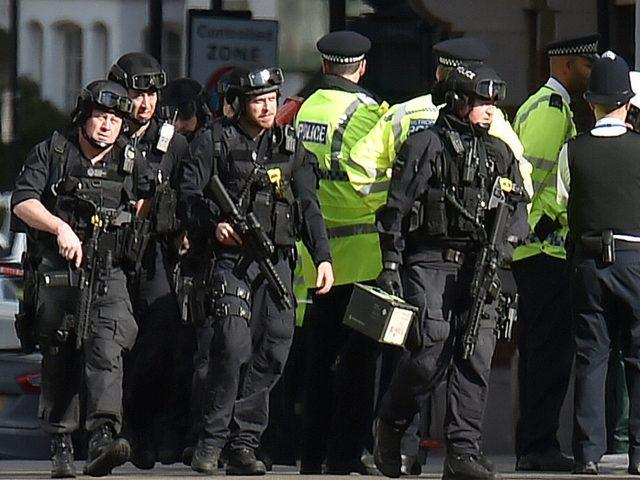 Armed police near Parsons Green station following Friday's attack