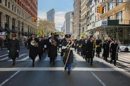 Brian Endlein (C), of the U.S. Army Reserve 78th Army Band, leads the band in marching during the annual New York City Veterans Day Parade in New York, NY, U.S., November 11, 2017. Picture taken November 11, 2017. Hector Rene Membreno-Canales/U.S. Army/Handout via REUTERS
