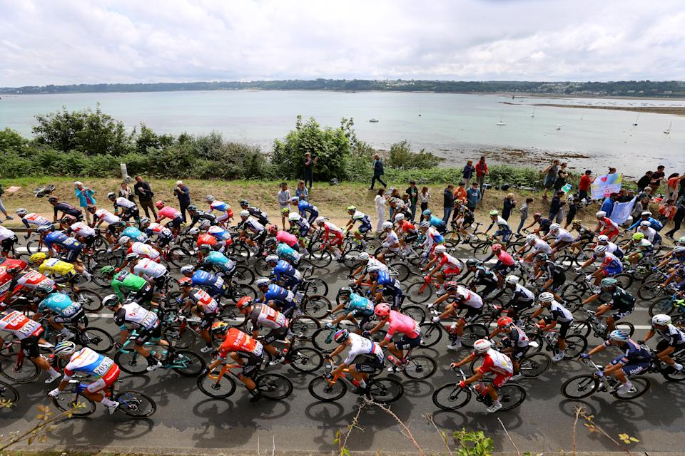 MÛR-DE-BRETAGNE GUERLÉDAN, FRANCE - JUNE 27: Julian Alaphilippe of France and Team Deceuninck - Quick-Step yellow leader jersey, Michael Matthews of Australia and Team BikeExchange Green Points Jersey, Tadej Pogačar of Slovenia and UAE-Team Emirates white best young jersey,  Ide Schelling of The Netherlands and Team BORA - Hansgrohe Polka Dot Mountain Jersey & The peloton passing through Perros-Guirec city landscape at start during the 108th Tour de France 2021, Stage 2 a 183,5km stage from Perros-Guirec to Mûr-de-Bretagne Guerlédan 293m / Beach / Sea / @LeTour / #TDF2021 / on June 27, 2021 in Mûr-de-Bretagne Guerlédan, France. (Photo by Tim de Waele/Getty Images)