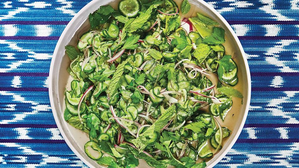 "Cool, crunchy, and a bit sweet, this salad is meant to quench the fire from all the other dishes on the table. <a href=""https://www.bonappetit.com/recipe/cucumber-and-onion-salad?mbid=synd_yahoo_rss"" rel=""nofollow noopener"" target=""_blank"" data-ylk=""slk:See recipe."" class=""link rapid-noclick-resp"">See recipe.</a>"