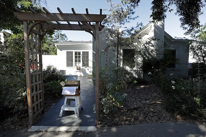 """A box of limes, rosemary, blue basil and zucchini is offered for sharing in Silver Lake. <span class=""""copyright"""">(Myung J. Chun / Los Angeles Times)</span>"""