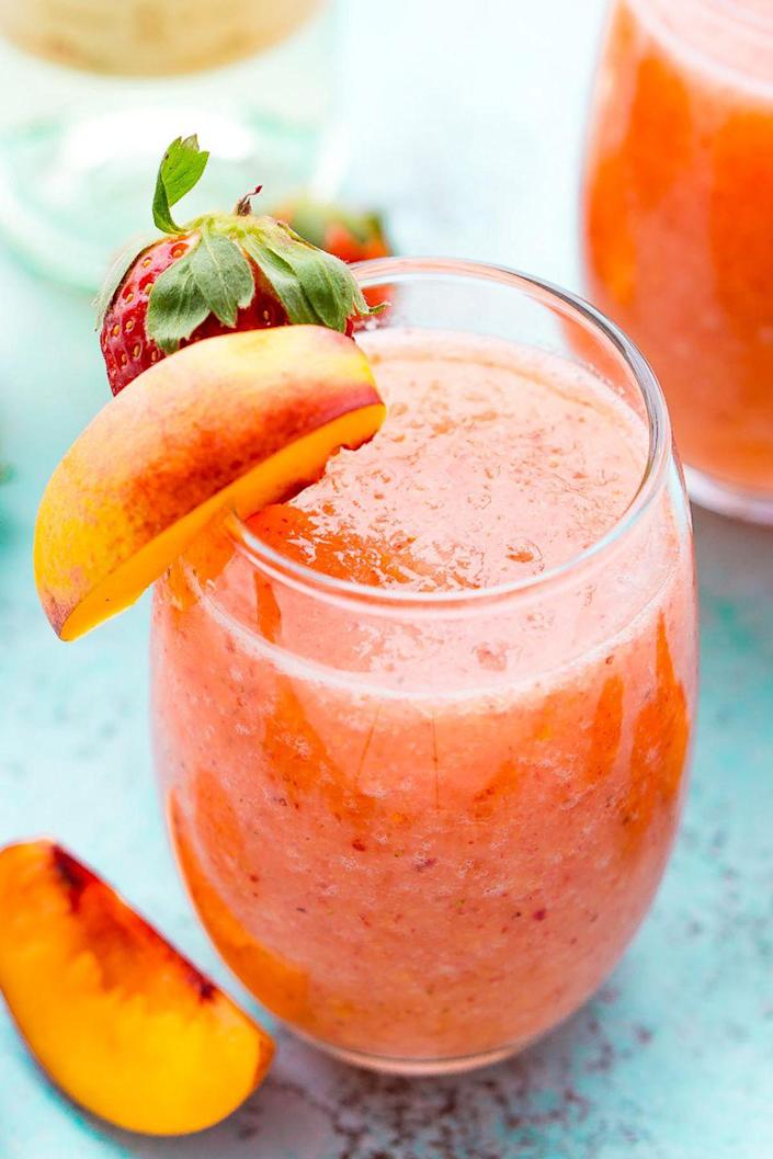 "<p>Stay cool during the dog days of summer with this fruity wine cocktail. </p><p><strong>Get the recipe at <a href=""https://www.sugarandsoul.co/strawberry-peach-wine-slushies-recipe/"" rel=""nofollow noopener"" target=""_blank"" data-ylk=""slk:Sugar & Soul"" class=""link rapid-noclick-resp"">Sugar & Soul</a>.</strong></p>"