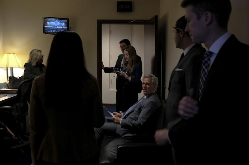 House Minority Leader Kevin McCarthy (R-Calif.) reads over his notes with other GOP leaders before a press conference denouncing the vote on the articles of impeachment at the Capitol in Washington, D.C., on Dec. 17, 2019. | Gabriella Demczuk for TIME
