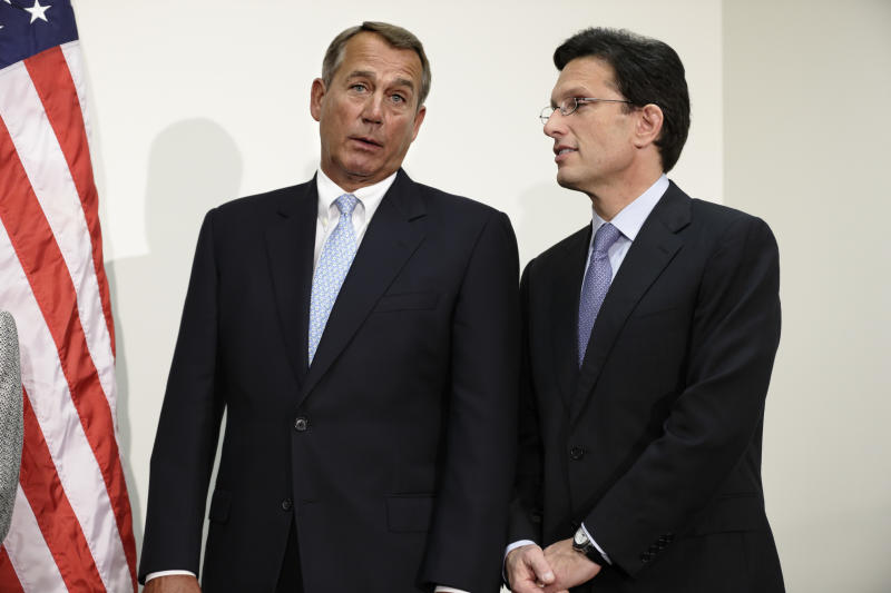 House Speaker John Boehner Ohio, left, talks with House Majority Leader Eric Cantor of Va., on Capitol Hill in Washington, Wednesday, Nov. 28, 2012, during a news conference following a closed strategy session. (AP Photo/J. Scott Applewhite)