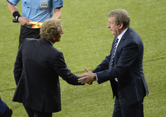 English headcoach Roy Hodgson (R) shakes hands with Swedish headcoach Erik Hamren at the end of the Euro 2012 championships football match Sweden vs England on June 15, 2012 at the Olympic Stadium in Kiev. England won 3 to 2.          AFP PHOTO / JONATHAN NACKSTRANDJONATHAN NACKSTRAND/AFP/GettyImages