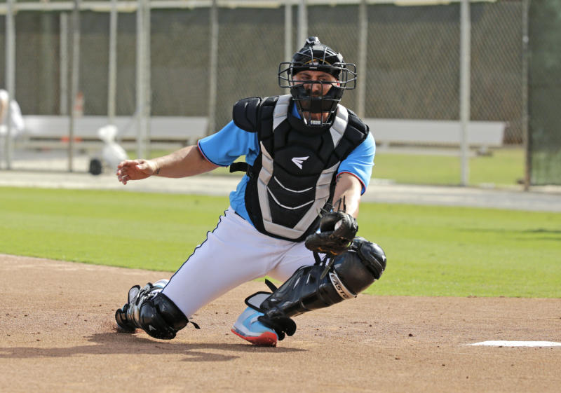 FILE - In this Feb. 12, 2020, file photo, Miami Marlins catcher Francisco Cervelli run drills during a spring training baseball workouts for pitchers and catchers at Roger Dean Stadium in Jupiter, Fla. Cervelli says he's fully recovered from his latest concussion, and Jorge Alfaro says he's feeling fitter after an offseason spent working on the farm and running sprints. At catcher, at least, the Miami Marlins appear in good shape. (David Santiago/Miami Herald via AP, File)