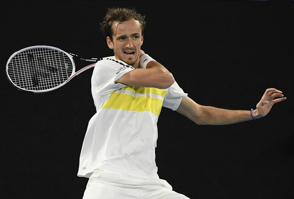 Russia's Daniil Medvedev hits a forehand return to Serbia's Novak Djokovic during the men's singles final at the Australian Open tennis championship in Melbourne, Australia, Sunday, Feb. 21, 2021.(AP Photo/Andy Brownbill)