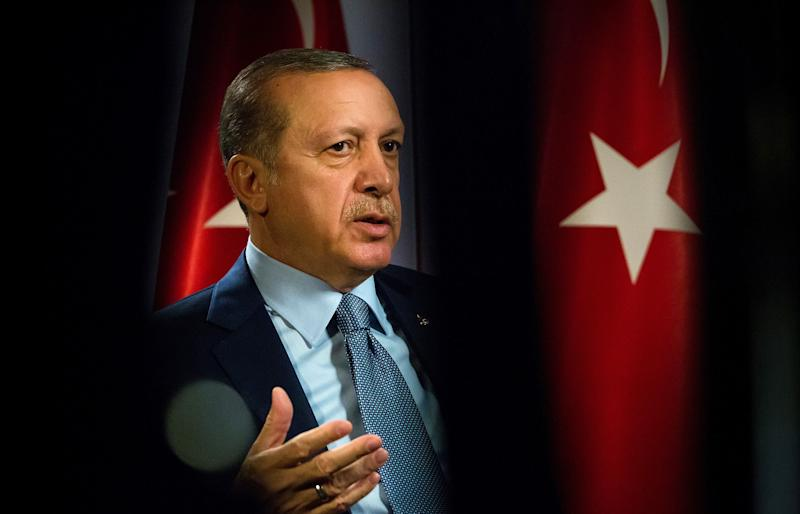 """(Bloomberg) -- Turkey is about to embark on one of the greatest central banking experiments in emerging markets -- and the timing couldn't be better.Long a believer that high interest rates cause inflation, President Recep Tayyip Erdogan is finally putting that unconventional theory into practice by installing Murat Uysal as governor this month after firing his predecessor for failing to cut sooner.As the drumbeat of political pressure grows on central banks from the U.S. to India, Erdogan has one-upped his counterparts thanks to broad new powers granted to his office after last year's general election. A policy meeting on Thursday will show just how sharp a pivot the central bank is prepared to make.Turkey is ripe for monetary easing. A dovish turn in monetary policy globally and a downswing in inflation has left Turkey with the world's highest real rate. Powerful base effects will likely continue to choke off price growth in the months ahead.""""To achieve an economic recovery, the central bank needs to ease fast enough and yet not so fast, given the implied weakness in the Turkish lira and imported inflation,"""" said Sebastien Galy, a senior macro strategist at Nordea Investment Funds in Luxembourg.Erdogan's power grab was years in the making, a culmination of his distaste for high rates that's been linked to Islamic proscriptions on usury. In his view, producers have to pass on their higher borrowing costs to customers, so they raise prices.Erdogan promised to take more direct control over rate decisions in an interview last year and warned following a massive rate increase in September that """"there is a limit"""" to his patience. The tipping point came when former Governor Murat Cetinkaya extended a policy pause to nine months in June, prompting Erdogan to call the 24% benchmark """"unacceptable.""""The new governor, though, is boxed in between anxious markets and an impatient president. Although every economist surveyed by Bloomberg predicts Turkey will cut its interest rate"""