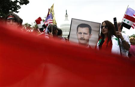 Syrian Americans rally in support of the regime of Syrian President Bashar al-Assad and against proposed U.S. military action against Syria, in a park at the U.S. Capitol in Washington, September 9, 2013. REUTERS/Jonathan Ernst