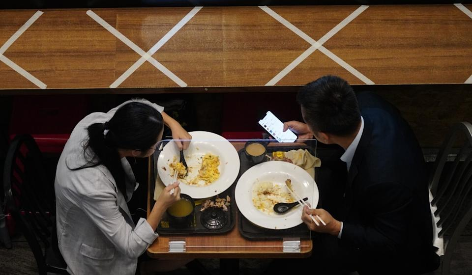 Restaurants are currently not allowed to serve more than two people at a table, and must stop offering dine-in service at 6pm. Photo: Sam Tsang
