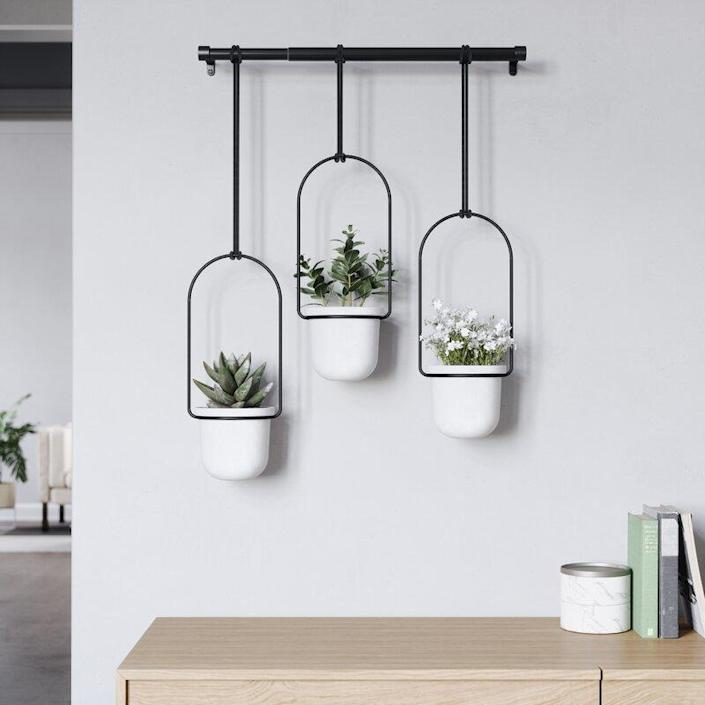 "More is more! Hang three plants with this hanging trio that will provide an excellent home to plants or herbs. $60, Wayfair. <a href=""https://www.wayfair.com/outdoor/pdp/umbra-triflora-hanging-melamine-hanging-planter-vbbq1017.html"" rel=""nofollow noopener"" target=""_blank"" data-ylk=""slk:Get it now!"" class=""link rapid-noclick-resp"">Get it now!</a>"