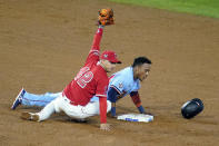 Minnesota Twins' Jorge Polanco, right, is safe at second base next to Los Angeles Angels second baseman David Fletcher on a pick-off attempt during the sixth inning of a baseball game Friday, April 16, 2021, in Anaheim, Calif. (AP Photo/Marcio Jose Sanchez)